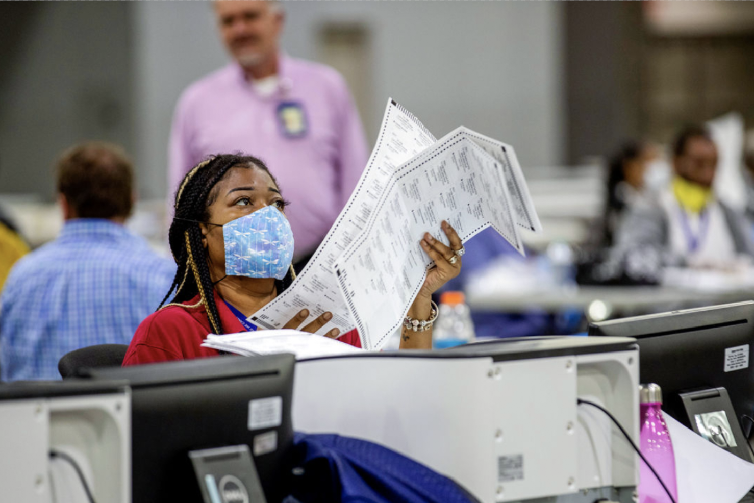 Voting by mail hasn't given a big advantage to one political party, but Republican rhetoric could change the dynamic for November's election. ALYSSA POINTER/ATLANTA JOURNAL-CONSTITUTION VIA AP