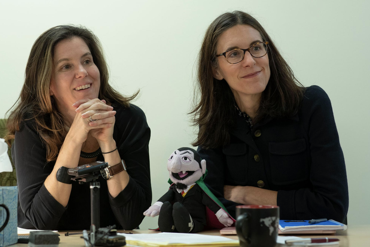 "Frank Batten School of Leadership and Public Policy professors of practice Kirsten Gelsdorf and Lucy Bassett with ""Sesame Street"" character Count Von Count. (Photo by Dan Addison, University Communications)"